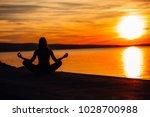 carefree calm woman meditating... | Shutterstock . vector #1028700988