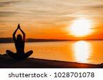 carefree calm woman meditating... | Shutterstock . vector #1028701078