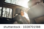 young woman in a car female... | Shutterstock . vector #1028701588