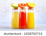 bottles with fresh orange ... | Shutterstock . vector #1028702713