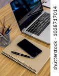 laptop  pencils  notebook on... | Shutterstock . vector #1028717014