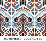Ikat geometric folklore ornament. Tribal ethnic vector texture. Seamless striped  pattern in Aztec style. Figure tribal  embroidery. Indian, Scandinavian, Gypsy, Mexican, folk pattern.  | Shutterstock vector #1028717680