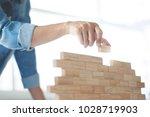 Woman holding blocks wood game  ...