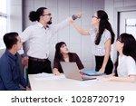 business people having an... | Shutterstock . vector #1028720719