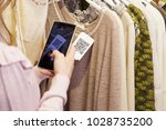 woman scanning a qr code  with... | Shutterstock . vector #1028735200