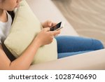 cropped image of teenage girl... | Shutterstock . vector #1028740690