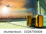 traveling luggage in airport... | Shutterstock . vector #1028750008