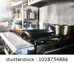 wok on gas stove getting hot in ... | Shutterstock . vector #1028754886
