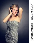 young cheerful girl listening... | Shutterstock . vector #1028756614
