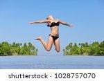 young girl in bikini is resting ... | Shutterstock . vector #1028757070