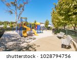 playground and park in suburban ... | Shutterstock . vector #1028794756