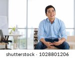 portrait of cheerful young... | Shutterstock . vector #1028801206