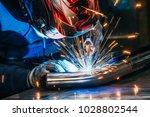 welder in mask welding metal... | Shutterstock . vector #1028802544