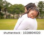 sleeping little girl on father... | Shutterstock . vector #1028804020