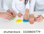 girls with father and mother... | Shutterstock . vector #1028804779
