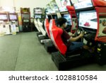 a man playing the car racing... | Shutterstock . vector #1028810584