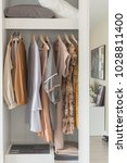 wooden wardrobe with clothes... | Shutterstock . vector #1028811400