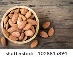 almonds in brown bowl on... | Shutterstock . vector #1028815894