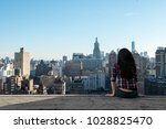 a woman sits on the edge of a... | Shutterstock . vector #1028825470