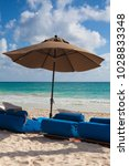 luxury blue beach chairs on the ... | Shutterstock . vector #1028833348