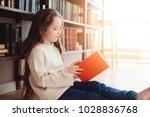 happy smart schoolgirl reading... | Shutterstock . vector #1028836768