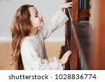 happy smart schoolgirl reading... | Shutterstock . vector #1028836774