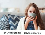 child girl drinking hot tea to... | Shutterstock . vector #1028836789