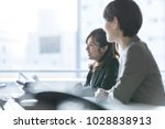 Small photo of Businesswomen working in the office. Positive workplace concept.