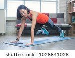 asian women exercise indoor at... | Shutterstock . vector #1028841028