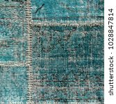detail of a old blue patchwork... | Shutterstock . vector #1028847814