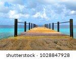 tropical pier into the azure... | Shutterstock . vector #1028847928