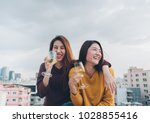 happy asia girl friends enjoy... | Shutterstock . vector #1028855416