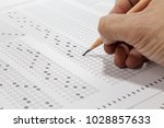 students hand doing exams quiz... | Shutterstock . vector #1028857633