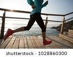 fitness sporty female runner...   Shutterstock . vector #1028860300