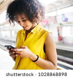 young woman using a smartphone... | Shutterstock . vector #1028868898