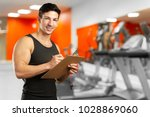 strong personal trainer | Shutterstock . vector #1028869060