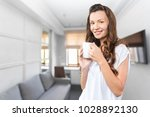 beautiful woman with cup of tea | Shutterstock . vector #1028892130