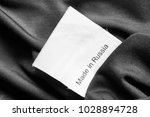 clothes label lettered made in... | Shutterstock . vector #1028894728