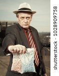 older dealer of narcotics...   Shutterstock . vector #1028909758