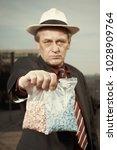 older dealer of narcotics...   Shutterstock . vector #1028909764