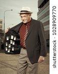 older dealer of narcotics...   Shutterstock . vector #1028909770
