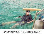 divers on the surface of water... | Shutterstock . vector #1028915614