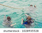 divers on the surface of water... | Shutterstock . vector #1028935528
