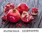 ripe pomegranate fruits on the... | Shutterstock . vector #1028944990