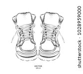beautiful stylish leather boots.... | Shutterstock .eps vector #1028959000