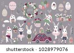 Stock vector big set of cute happy easter cartoon characters and design elements bunnies easter eggs flowers 1028979076