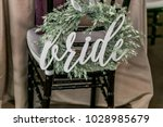 bride sign on a decorated chair | Shutterstock . vector #1028985679
