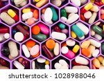 various pills and capsules on... | Shutterstock . vector #1028988046