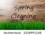 sunny wooden background  gras ... | Shutterstock . vector #1028991148