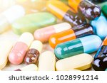 medicine pills or capsules on... | Shutterstock . vector #1028991214
